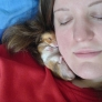 Woman sleeping with hamster